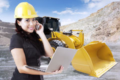 Young contractor with backhoe Stock Photo