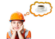 Young contractor and coffee. Relaxing Stock Photography