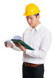 Young contractor with hardhat and clipboard Stock Photos