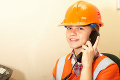 Young contractor on the phone in the office Royalty Free Stock Photos