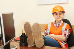 Young contractor relaxing in the office Royalty Free Stock Photo