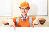 Young contractor shows gesture in the office Royalty Free Stock Images
