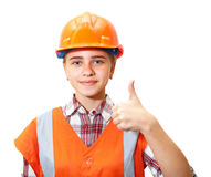 Young contractor shows gesture in the office Royalty Free Stock Image