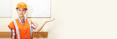 Young contractor shows gesture in the office Royalty Free Stock Photography
