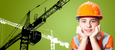 Young contractor and silhouettes of the cranes Stock Image