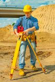 A young contractor with theodolite Royalty Free Stock Photos