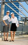 Young contractors. Young female contractors in a front of building site royalty free stock images