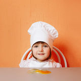 Young cook with broken egg Royalty Free Stock Photography