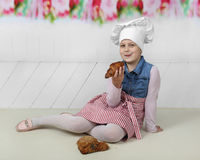 Young cook with buns royalty free stock photo