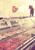 Young cook at butcher store Royalty Free Stock Photography
