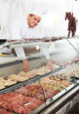 Young cook at butcher store Royalty Free Stock Photo