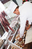 Young cook at butcher store Stock Images