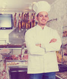 Young cook at butcher store Royalty Free Stock Image