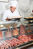 Young cook at butcher store Royalty Free Stock Photos