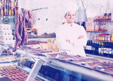 Young cook at butcher store Stock Image