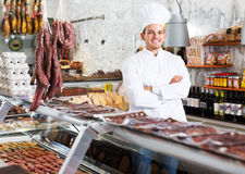 Young cook at butcher store Royalty Free Stock Images