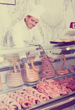 Young cook at butcher store Stock Photos