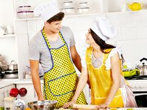 Young cook cooking at kitchen. Royalty Free Stock Image