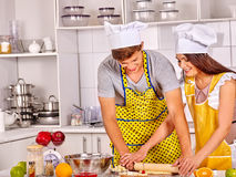 Young cook cooking at kitchen Royalty Free Stock Image