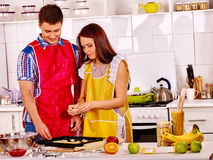 Young cook cooking at kitchen Stock Images
