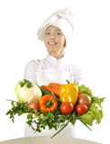 Young cook female  with bunch of vegetables Stock Photos