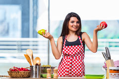 The young cook with fruits in the kitchen Royalty Free Stock Image