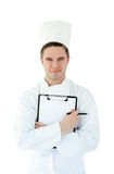 Young cook holding a clipboard Royalty Free Stock Photo