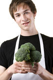 Young cook holding fresh Broccoli Royalty Free Stock Image