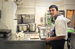 Young cook in a kitchen Royalty Free Stock Photography