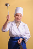 Young cook with kitchenware Royalty Free Stock Photo