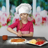 Young cook makes pizza Royalty Free Stock Photography