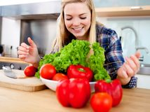 Young cook making salad Stock Photography