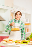 Young cook preparing traditional American food Stock Photo