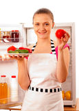 Young cook smiling with frash vegetables Stock Photo