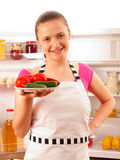 Young cook smiling with fresh vegetables Royalty Free Stock Photos