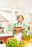 Young cook with tasty pizza in the kitchen Royalty Free Stock Photo