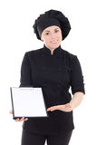 Young cook woman in black uniform with clipboard isolated on whi Royalty Free Stock Photos