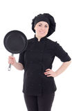 Young cook woman in black uniform with frying pan isolated on wh Royalty Free Stock Photo