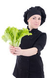Young cook woman in black uniform with green salad isolated on w Royalty Free Stock Photo