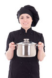 Young cook woman in black uniform with pan isolated on white Stock Photography