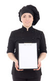 Young cook woman in black uniform showing clipboard isolated on Stock Images