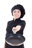 Young cook woman in black uniform with teflon frying pan isolate Stock Photos