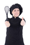Young cook woman in black uniform thumbs up isolated on white Stock Photography