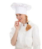 Young cook woman trying to eat chilli Royalty Free Stock Image