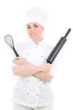 Young cook woman in uniform with baking rolling pin and corolla Stock Photos