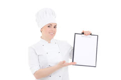 Young cook woman in uniform holding clipboard with copyspace iso Stock Photography
