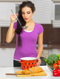 Young cooking woman Royalty Free Stock Photos
