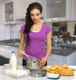 Young cooking woman Stock Image