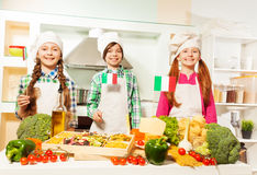 Young cooks preparing traditional Italian meal Royalty Free Stock Image