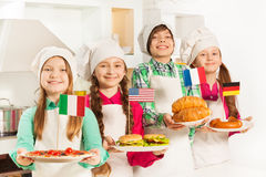 Young cooks with traditional food of their states Royalty Free Stock Photography
